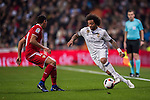 """Marcelo Vieira Da Silva (r) of Real Madrid competes for the ball with Paulo Henrique Chagas de Lima """"Ganso"""" of Sevilla FC during their Copa del Rey Round of 16 match between Real Madrid and Sevilla FC at the Santiago Bernabeu Stadium on 04 January 2017 in Madrid, Spain. Photo by Diego Gonzalez Souto / Power Sport Images"""
