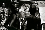 Two boys in Freetown inspect an Indian cinema poster. Such violent imagery is commonplace. Freetown, Sierra Leone 1997