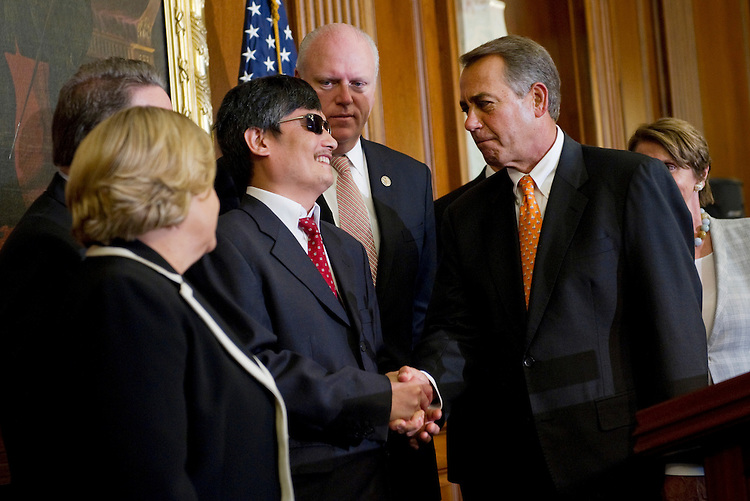 UNITED STATES - AUGUST 1: Chinese dissident Chen Guangcheng (C) shakes hands with House Speaker John Boehner, R-Ohio, at a press conference in the U.S. Capitol. (Photo By Chris Maddaloni/CQ Roll Call)