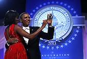 United States President Barack Obama dances with first lady Michelle Obama during the Inaugural Ball January 21, 2013 at Walter E. Washington Convention Center in Washington, DC. Barack Obama was re-elected for a second term as President of the United States. .Credit: Alex Wong / Pool via CNP