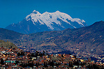 The major landmark of the city of La Paz is snow covered Mt Illimani, rising over the city at dusk.  Illimani is the second highest peak in Bolivia