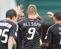 Danny Allsopp #9 of D.C. United is congratulated after scoring one of his three goals during an international friendly match against Portsmouth FC at RFK Stadium on July 24 2010, in Washington D.C. United won 4-0.