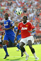 Mame Biram Diouf.Shavar Thomas (blue)..Kansas City Wizards defeated Manchester United 2-1 in an international friendly at Arrowhead Stadium, Kansas City, Missouri.