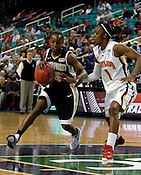 Maryland vs. Wake Forest battle during the semifinals of the 2012 ACC Women's Basketball Tournament at the Greensboro Coliseum in Greensboro, NC. Photo by Al Drago.