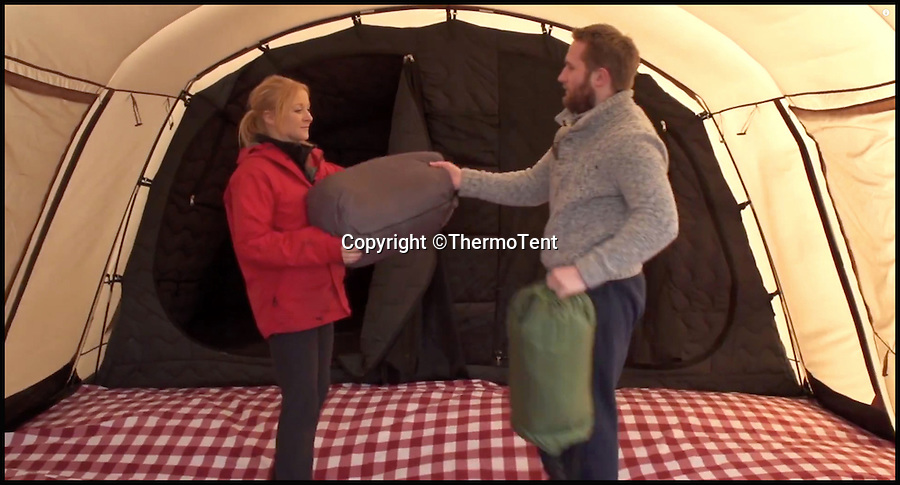 BNPS.co.uk (01202 558833)<br /> Pic: ThermoTent/BNPS<br /> <br /> Setting up the Thermo Tent.<br /> <br /> An inventor is hoping to revolutionise the camping world just in time for the notorious British summer after launching an insulated tent that keeps campers warm in cold weather and cool in the heat.<br /> <br /> Derek O'Sullivan says his Thermo Tent will finally end the age-old problem of campers being freezing cold at night then boiling hot once the sun comes up by mimicking house insulation.<br /> <br /> It means the temperature inside the tent remains stable, putting paid to common camping problems like having to take extra sleeping bags or having to wake up at the crack of dawn to let fresh air in.<br /> <br /> And Derek says that thanks to the insulation his Thermo Tents also block out noise, saving campers the misery of being kept awake by revellers or being woken early by screaming children.<br /> <br /> He has now launched the product on crowdfunding website Kickstarter where it has captured the imaginations of the online community -  almost all of the 40,000 euros he needs to get his company started has been pledged.