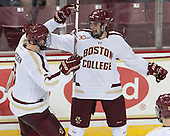 Chris Calnan (BC - 11) celebrates his first collegiate goal with Ian McCoshen (BC - 3). - The Boston College Eagles defeated the visiting Rensselaer Polytechnic Institute Engineers 7-2 on Sunday, October 13, 2013, at Kelley Rink in Conte Forum in Chestnut Hill, Massachusetts.