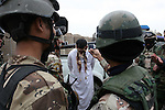 Police in the town of Aitha, in northern Iraq, take photos and video of a captured insurgent before he is transported to jail. U.S. officers with 1st Squadron, 3rd Armored Cavalry Regiment say that an offer of amnesty  under a U.S.-backed reconciliation program has convinced some Sunni insurgent leaders in the area to lay down their arms and provide valuable intelligence on others who refuse to stop fighting. Feb. 11, 2008. DREW BROWN/STARS AND STRIPES