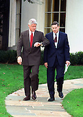 United States President Bill Clinton checks his watch as he walks with Michael Casserly, Director of the Council of Great City Schools on 31 October, 1999.  Clinton was making remarks as he left for the summit in Oslo, Norway to meet with Israeli Prime Minister Ehud Barak and Palestinian Leader Yasser Arafat.  In his remarks he criticized GOP lawmakers for failing to carry out their promise to hire 100,000 new teachers nationwide.  Clinton's remarks coincided with the release of the Council of Great City Schools' study touting the benefits of low teacher-pupil ratios in schools.<br /> Credit: Ron Sachs / CNP