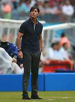 Germany coach Joachim Loew looks on after changing his shirt at half time
