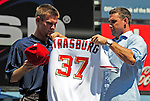 21 August 2009: Washington Nationals' first round draft pitcher Stephen Strasburg (left) received his jersey from Ryan Zimmerman (right) after being formally introduced to the media during a televised event at Nationals Park in Washington, DC. The Nationals agreed to terms with Strasburg, the 2009 number one overall pick in this years' MLB Draft, with fewer than two minutes before the signing deadline. Mandatory Credit: Ed Wolfstein Photo