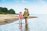 Mother and daughter walking on Kauksi beach. Lake Peipsi in Estonia.