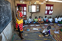 BRAC PROJECT, Hai Kugi School 1. Margaret Sunday, trained teacher at BRAC sponsored school of 30 students all about age 8.