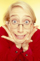 Stock photo of a surprized blond woman with a shocked expression.