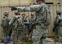 Soldiers of the Georgia Army National Guard, 48th Brigade, 1st and 2nd Battalion, 121st Infantry Regiment, and the 1st Battalion, 118th Artillery Regiment practice scenarios at Camp Shelby, Mississippi on Friday, May 8, 2009 in preparation for their deployment to Afghanistan. Their mission is to help train the Afghan National Army and Police forces. Foreign nationals and Mississippi locals act as townspeople, police and soldiers during the scenarios...Still image taken from video.