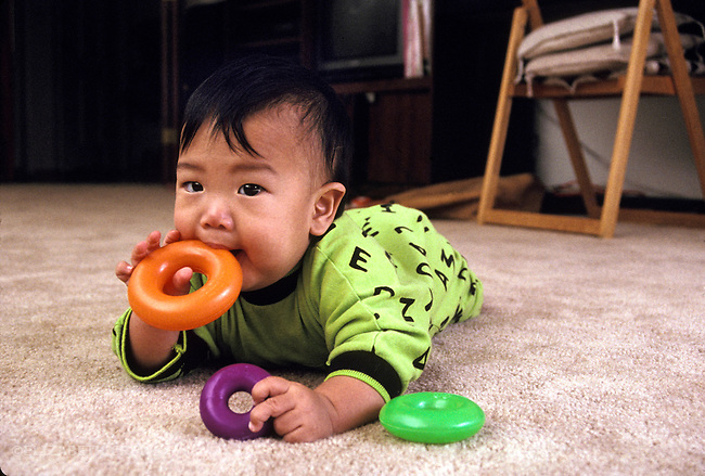 Palo Alto CA Baby c. ten-months -old mouthing plastic rings