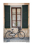 Bicycle on the plaza, Petra, Mallorca, Spain by Larry Angier.
