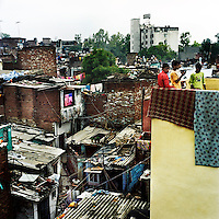 The Kathputli Colony, located in northwest Delhi, is inhabited by approximately 2,000 performing artists, practicing traditional art forms such as marionette puppetry, juggling, magic, acrobatics, dance and music. Many have travelled all over the world showcasing their abilities, but they still choose to remain living in this slum, which is one of the most impoverished in the city.