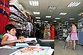KAZ / Kasachstan / Almaty / 27.07.213 / Portrait der 35jährigen Arzu Almassova mit Glasknochenkrankheit. Sie ist Unternehmerin und betreibt zwei Schönheitssalons und ein Kaufhaus. Hier macht sie die Abrechnung in der Abteilung für Oberbekleidung in ihrem Kaufhaus. / Portrait of 35 years old Arzu Almassova. She was diagnosed with brittle bone disease, Osteogenesis imperfecta, shortly after birth. Nevertheless she runs two hairdresser's and manicure shops and a department store. Here she checks the accounting of the fashion boutique in her store.