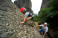 Meteora, Greece, May 2005. Climbers try to conquer the Spindle, one of the numorous climbing routes in Meteora. The rocks of meteora offered a safety to the many monasteries that were built on top of them. Nowadays it is known as a climbers paradise. Photo by Frits Meyst/Adventure4ever.com