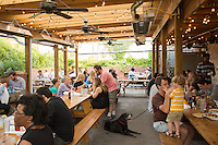 DURHAM, N.C. Tuesday August 5, 2014 - Cole Brooks, 3, and his father Grey (BOTH CQ) Geer Street Garden, a renovated service station, in Durham, N.C. (Justin Cook for The New York Times)