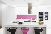 A breakfast bar with Koncord bar stools in black and pink offers another option to the dining table