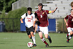 30 August 2013: Northeastern's Dante Marini (14) and Elon's Nick Butterly (3). The Elon University Phoenix played the Northeastern University Huskies at Koskinen Stadium in Durham, NC in a 2013 NCAA Division I Men's Soccer match. The game ended in a 1-1 tie after two overtimes.