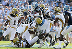 08 November 2008: North Carolina's Ryan Houston (32) is tackled by Georgia Tech's Dominique Reese (26) and teammates. The University of North Carolina Tarheels defeated the Georgia Tech University Yellow Jackets 28-7 at Kenan Stadium in Chapel Hill, NC in an NCAA Division I and Atlantic Coast Conference football game.