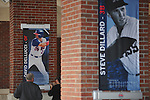 Jay Leonardo (left) and Jeremy Dana of Design & Display install banners of Ole Miss All-American baseball players at Oxford-University Stadium in Oxford, Miss. on Monday, February 11, 2013. 17 banners are being erected and signage in the stadium is being updated.