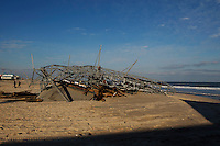 Parts of a roller coaster is seen sitting next to the ocean, when the boardwalk it was built upon collapsed during Hurricane Sandy, in Seaside Heights, New Jersey, November 28, 2012.