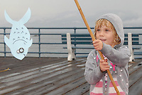 Delphine Gregory, 5,  fishes at the Santa Monica Pier during the  Santa Monica Jaycees (Santa Monica Junior Chamber)  55th annual Huck Finn Day on Saturday, October 2, 2010.