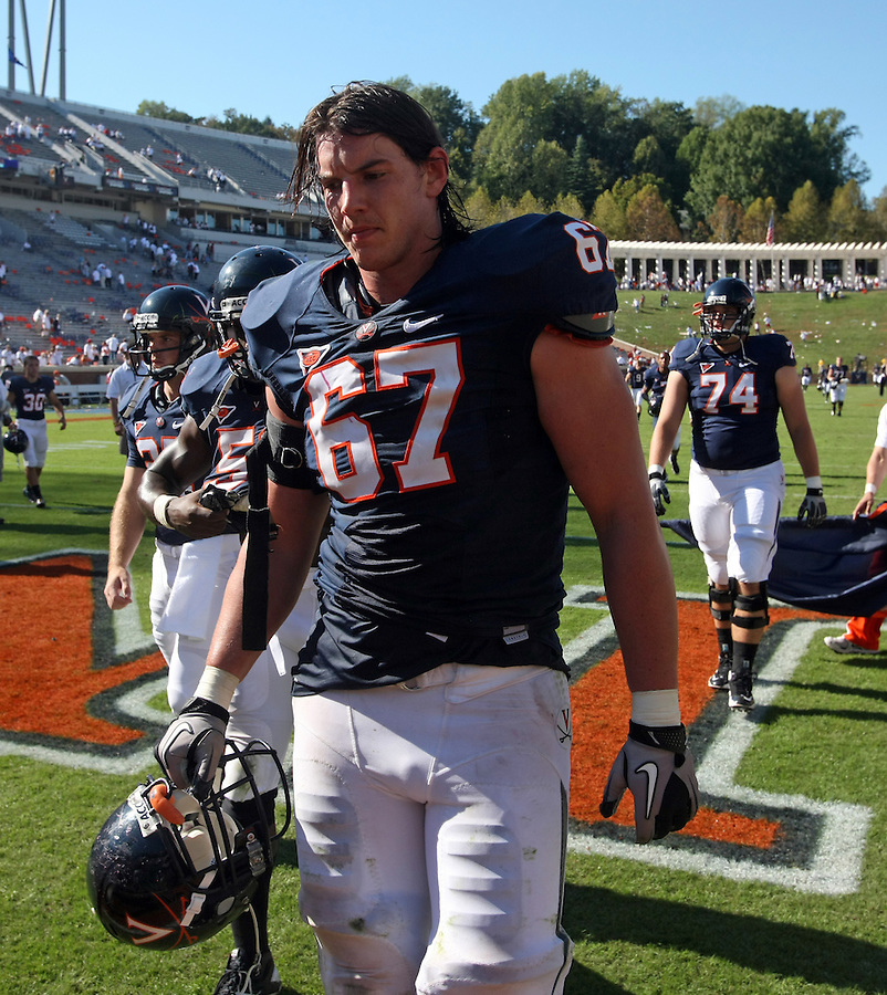Oct 2, 2010; Charlottesville, VA, USA; Virginia Cavaliers offensive tackle Landon Bradley (67) walks off the field after being defeated by the Florida State Seminoles at Scott Stadium. Florida State won 34-14.  Mandatory Credit: Andrew Shurtleff