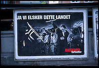 Neo-nazis taunt opposing demonstrators during a confrontation in Oslo, Norway 1995. ..Made into poster for leftist newspaper Klassekampen...