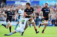 Michael Rhodes of Saracens looks to offload the ball after being tackled. European Rugby Champions Cup Quarter Final, between Saracens and Glasgow Warriors on April 2, 2017 at Allianz Park in London, England. Photo by: Patrick Khachfe / JMP