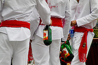 Young runners drinking sangria during the San Fermín festival in Pamplona, Spain, 7 July 2005.