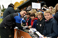 Matt Banahan of Bath Rugby mingles and signs autographs with supporters at the end of the session. Bath Rugby Captain's Run on October 30, 2015 at the Recreation Ground in Bath, England. Photo by: Patrick Khachfe / Onside Images