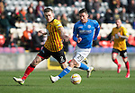 Partick Thistle v St Johnstone.....14.03.15<br /> Michael O'Halloran is closed down by Stephen O'Donnell<br /> Picture by Graeme Hart.<br /> Copyright Perthshire Picture Agency<br /> Tel: 01738 623350  Mobile: 07990 594431
