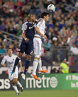New England Revolution midfielder Darrius Barnes (25) and Vancouver Whitecaps FC forward Omar Salgado (17) battle for head ball. In a Major League Soccer (MLS) match, the New England Revolution defeated the Vancouver Whitecaps FC, 1-0, at Gillette Stadium on May14, 2011.