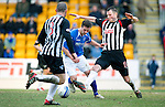 St Johnstone v Dunfermline....25.02.12   SPL.Chris Millar is tackled by Andy Dowie and Austin McCann.Picture by Graeme Hart..Copyright Perthshire Picture Agency.Tel: 01738 623350  Mobile: 07990 594431