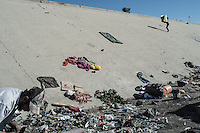 Migrant recycle rubbish en el Bordo for a living after having being deported from California. Tijuana, Mexico. Jan 5, 2015.