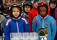 Oskar Ødegaard Mortensen (8)  and Kristian Tveiten  is at the front, waiting to get their prizes following a competition in Jardarkollen.