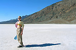 Young Woman Standing on Badwater Basin Salt Flats, Death Valley, California, USA