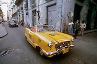 June, 1977. Havana, Cuba. Eighteen years after the Cuban Revolution the first U.S. tourists were permitted to visit Havana. Due to import restrictions, the most modern cars of Cuba date from 1958. The U.S. tourists were excited to shoot photographs of the beautifully maintained classic American cars.