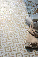 Laberinto, a stone hand-cut mosaic, shown in honed Calacatta and honed Jura Grey. Designed by Paul Schatz for New Ravenna.<br />