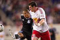 Justin Morrow (15) of the San Jose Earthquakes plays the ball away from Kenny Cooper (33) of the New York Red Bulls during the second half. The New York Red Bulls and the San Jose Earthquakes played to a 2-2 tie during a Major League Soccer (MLS) match at Red Bull Arena in Harrison, NJ, on April 14, 2012.
