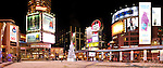 Panoramic view of Yonge-Dundas Square  public square in downtown Toronto Ontario Canada at night on New Year's eve. With Eaton Centre shopping mall entrance on the left and illuminated Christmas tree in the middle.