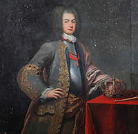 Portrait of King John V or Joao V of Portugal, 1689-1750, by Domenico Dupra, 1725, in the Black Room of the Joanina Library, or Biblioteca Joanina, a Baroque library built 1717-28 by Gaspar Ferreira, part of the University of Coimbra General Library, in Coimbra, Portugal. The Casa da Livraria was built during the reign of King John V or Joao V, and consists of the Green Room, Red Room and Black Room, with 250,000 books dating from the 16th - 18th centuries. The library is part of the Faculty of Law and the University is housed in the buildings of the Royal Palace of Coimbra. The building is classified as a national monument and UNESCO World Heritage Site. Picture by Manuel Cohen