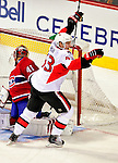 22 March 2010: Montreal Canadiens' goaltender Jaroslav Halak gives up the first goal of the game to Ottawa Senators center Peter Regin (43) at the Bell Centre in Montreal, Quebec, Canada. The Senators shut out the Canadiens 2-0 in their last meeting of the regular season. Mandatory Credit: Ed Wolfstein Photo