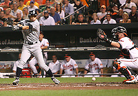 Ichiro Suzuki #51 of the Seattle Mariners hits a foul ball into the ground in front of Matt Weiters #32 of the Baltimore Orioles during a MLB game at Camden Yards, on August 8 2010, in Baltimore, Maryland. Orioles won 5-4 in extra innings.