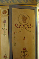 Detail of an 18th century hand-painted door in an elegant French apartment