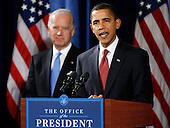 Chicago, IL - December 15, 2008 -- United States President-elect Barack Obama speaks during a news conference as Vice President-elect Joe Biden listens in Chicago, Illinois on Monday, December 15, 2008. .Credit: Jeff Haynes / CNP
